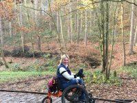 A wheelchair user on a board walk