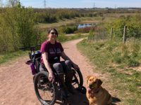 A wheelchair user with her service dog