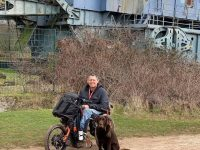A wheelchair user with his dog